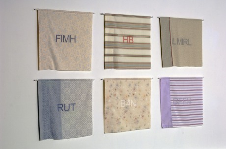 (dis)connect--Found pillowcase collages with sewn rod pockets, dowel rods